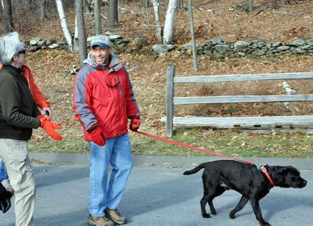 In a First Day Hike last Jan. 1, Massachusetts Gov. Deval Patrick and his dog Tobey step out at Mount Greylock State Reservation. (Associated Press)