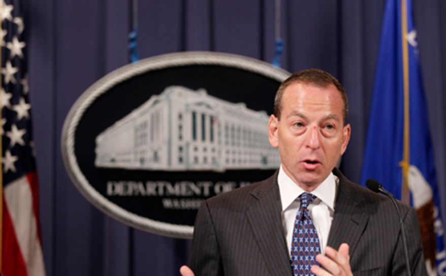**FILE** Assistant Attorney General Lanny Breuer speaks Oct. 4, 2010, during a news conference at the Justice Department in Washington. (Associated Press)