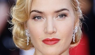 "British actress Kate Winslet arrives for the world premiere of the 3-D version of the film ""Titanic"" at the Royal Albert Hall in London on Tuesday, March 27, 2012. (AP Photo/Alastair Grant)"