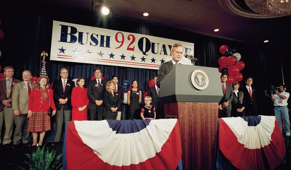 President  George H W Bush is joined by family members as he concedes to Bill Clinton on Nov. 3, 1992 at Houston hotel in Houston. (AP Photo/Ron Edmonds)