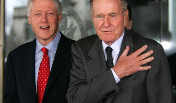 Former President Bush, right, and former President Bill Clinton emerge from meetings at the State Department Tuesday, March 8, 2005 in Washington. Former President Bill Clinton will undergo a medical procedure this week to remove fluid and scar tissue from his left chest, six months after he underwent quadruple bypass surgery, his office said Tuesday. (AP Photo/Charles Dharapak)