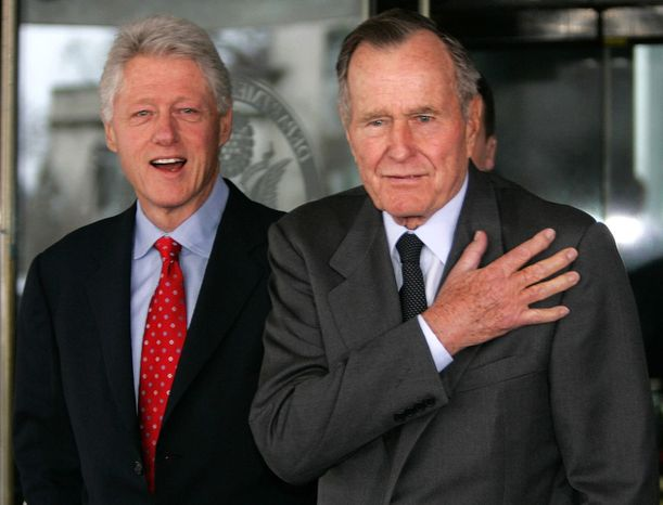 Former President Bush, right, and former President Bill Clinton emerge from meetings at the State Department Tuesday, March 8, 2005 in Washington. Former President Bill Clinton will undergo a medical procedure this week to remove fluid and scar tissue from his left che