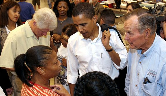 Former President Bill Clinton, left, Sen. Barack Obama, center, and former president George Bush meet with hurricane Katrina evacuees in the Reliant Center adjacent to the Astrodome in Houston, Monday, September 5, 2005. (AP Photo/Richard Carson, Pool)