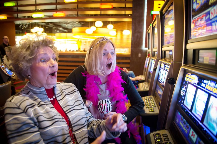 Barbara Boatman (left) and her granddaughter, Katherine Herbst, 21, both of Alexandria, Va., celebrate their birthdays on Dec. 27, 2012, at the Maryland Live Casino in Hanover, Md., which just announced it will be open 24 hours a day. (Rod Lamkey Jr./The Washington Times)