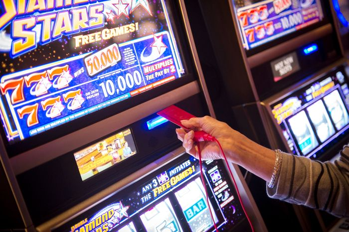 Barbara Boatman, of Alexandria, Va., tries her luck at a game at the Maryland Live Casino in Hanover, Md., on Dec. 27, 2012. Mrs. Boatman came to the casino with her granddaughter, Katherine Herbst, 21, to celebrate both of their recent birthdays. The casino is now open 24 hours a day. (Rod Lamkey Jr./The Washington Times)