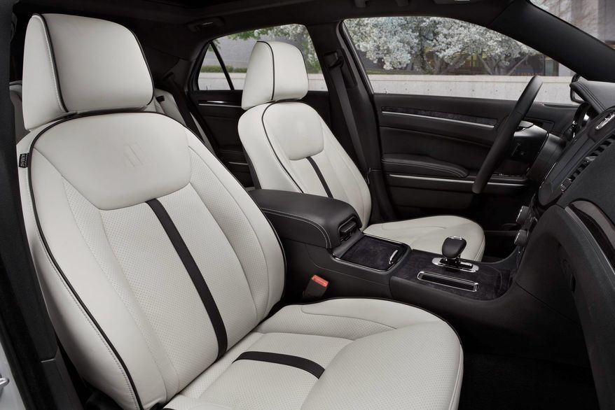 Unique Pearl White Nappa leather seating with perforated inserts are surrounded by a black interior environment for a contemporary look.