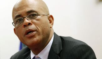 President Michel Martelly talks to reporters during a news conference, Monday, Dec, 10, 2012, in North Miami Beach, Fla. (AP Photo/Alan Diaz)