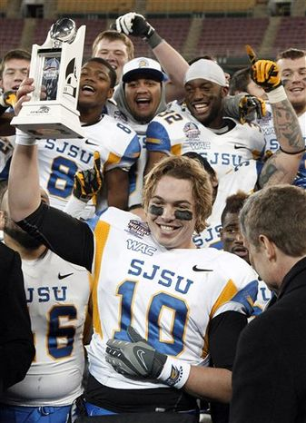 San Jose State quarterback David Fales (10) holds the most valuable player trophy after the Military Bowl college football game against Bowling Green at RFK Stadium Thursday, Dec. 27, 2012 in Washington. The Spartans won 29-20. (AP Photo/Alex Brandon)