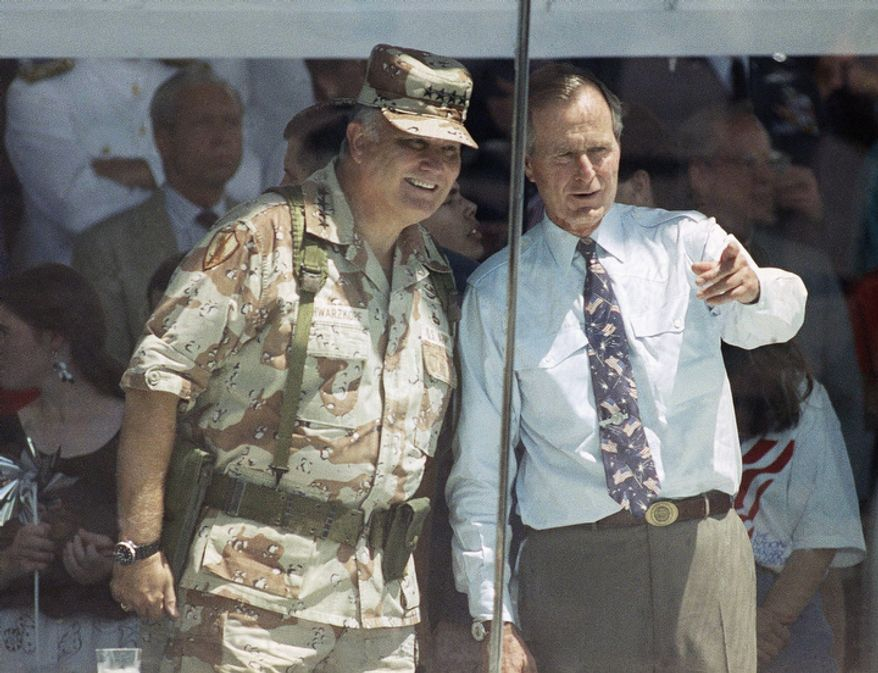 **FILE** Gen. Norman Schwarzkopf and President George Bush watch the National Victory Parade from the viewing stand in Washington on June 8, 1991. Schwarzkopf led his troops in the parade, and then joined Bush in the reviewing stand. (Associated Press)