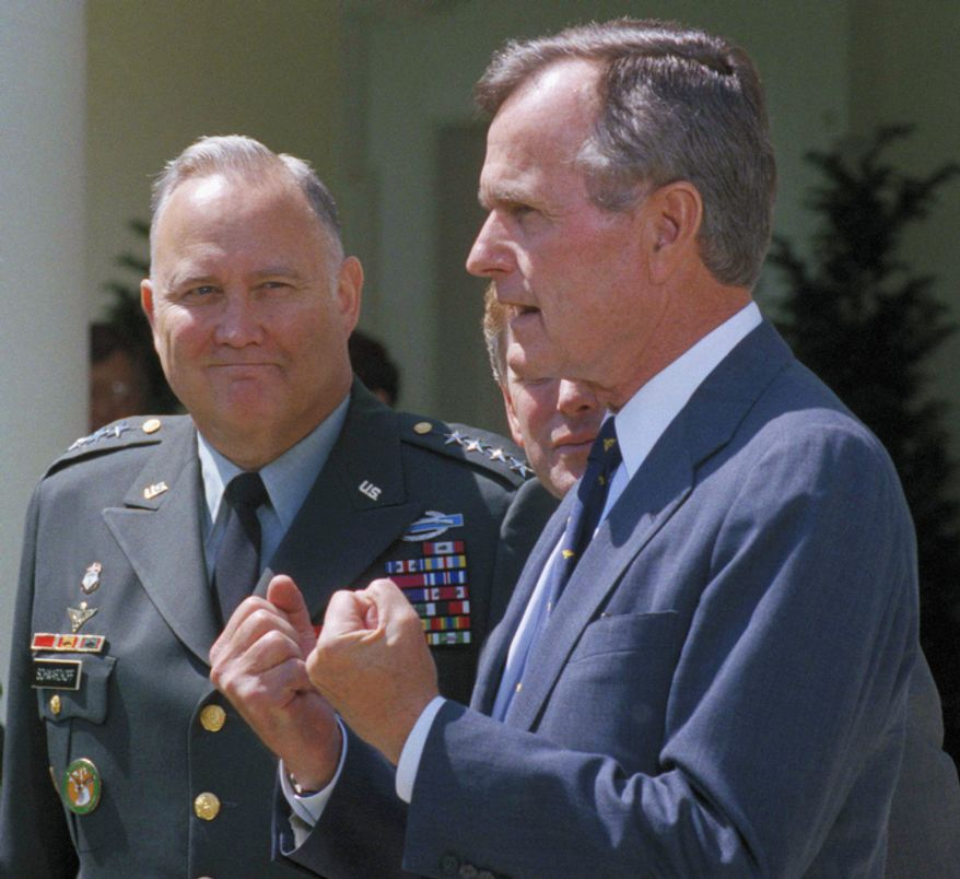 "**FILE** Gen. Norman Schwarzkopf (left) looks on as President George Bush speaks to reporters in the Rose Garden of the White House on April 23, 1991. Bush praised the general for leading a ""fantastic"" effort to fulfill U.S. obligations in the Gulf and for helping to build ""unbelievable"" morale on the home front. (Associated Press)"