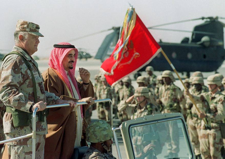 ** FILE ** King Fahd, second left, rides with U.S. Gen. Norman Schwarzkopf as they review U.S. troops at an airbase in eastern Saudi Arabia on Jan. 7, 1991. Fahd, who moved his country closer to the United States but ruled the world's largest oil producing nation in name only since suffering a stroke in 1995, died early Monday, Aug. 1, 2005 the Saudi royal court said. He was said to be 84. (AP Photo/Bob Daugherty)