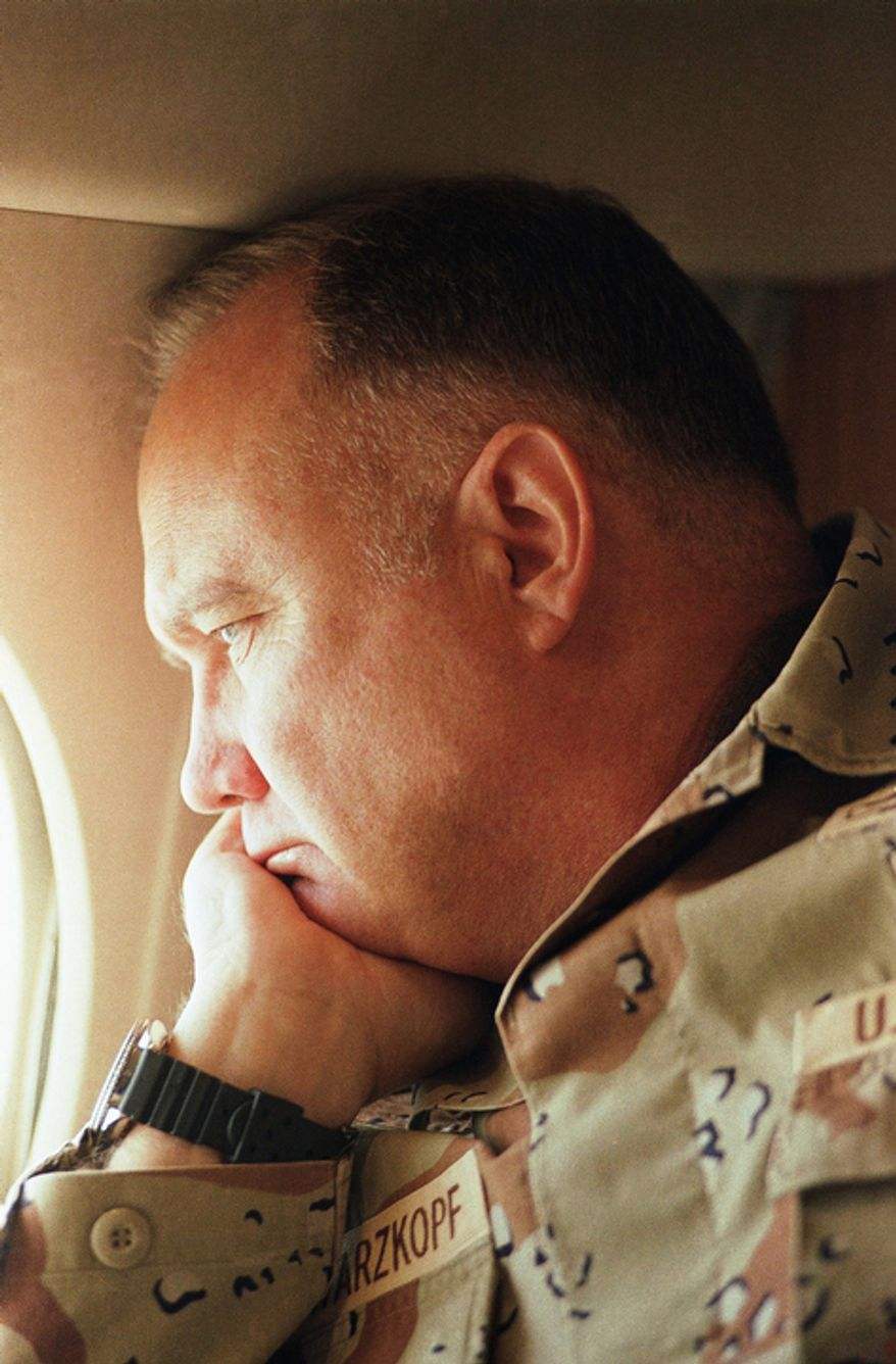 **FILE** Gen. H. Norman Schwarzkopf, commander of U.S. troops in the Gulf, gazes from the window of a small jet on his way out to visit U.S. troops in the desert in Saudi Arabia on Jan. 13, 1991. (Associated Press)