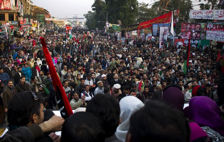 Supporters of former Pakistani Prime Minister Benazir Bhutto gather to pay tribute in Rawalpindi, Pakistan, on Thursday, Dec. 27, 2012, the fifth anniversary of her assassination. (AP Photo/B.K. Bangash)