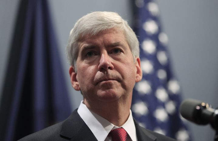 ** FILE ** Michigan Gov. Rick Snyder speaks at a news conference in Lansing, Mich., on Tuesday, Dec. 11, 2012. (AP Photo/C