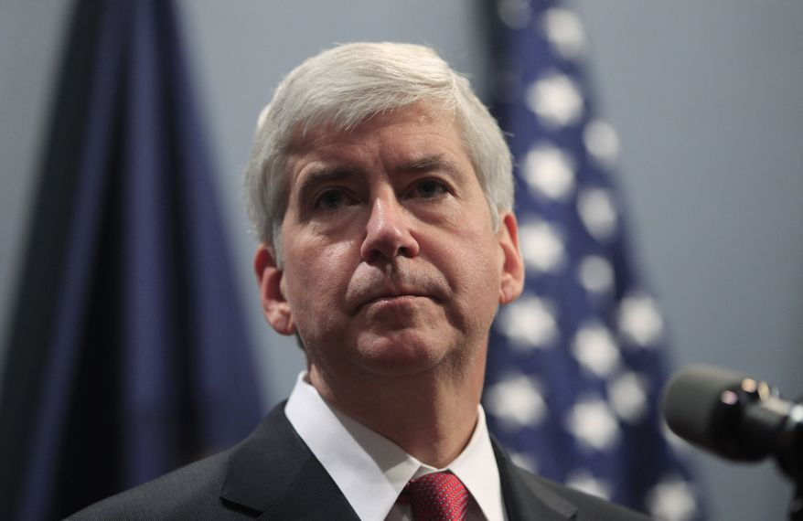 ** FILE ** Michigan Gov. Rick Snyder speaks at a news conference in Lansing, Mich., on Tuesday, Dec. 11, 2012. (AP Photo/Carlos Osorio)