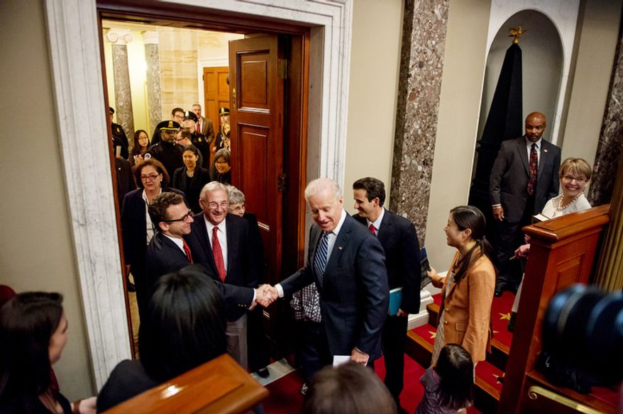 Vice President Joe Biden greets the family of Brian Emanuel Schatz (D-Hawaii), center right, before re-enacting Schatz's swearing in ceremony inside the old Senate Chamber at the U.S. Capitol Building, Washington, D.C., Thursday, December 27, 2012. Schatz, who was the Lt. Gov. for Hawaii was selected by Hawaii Gov. Neil Abercrombie to the U.S. Senate seat left vacant by the late Daniel K. Inouye. (Andrew Harnik/The Washington Times)