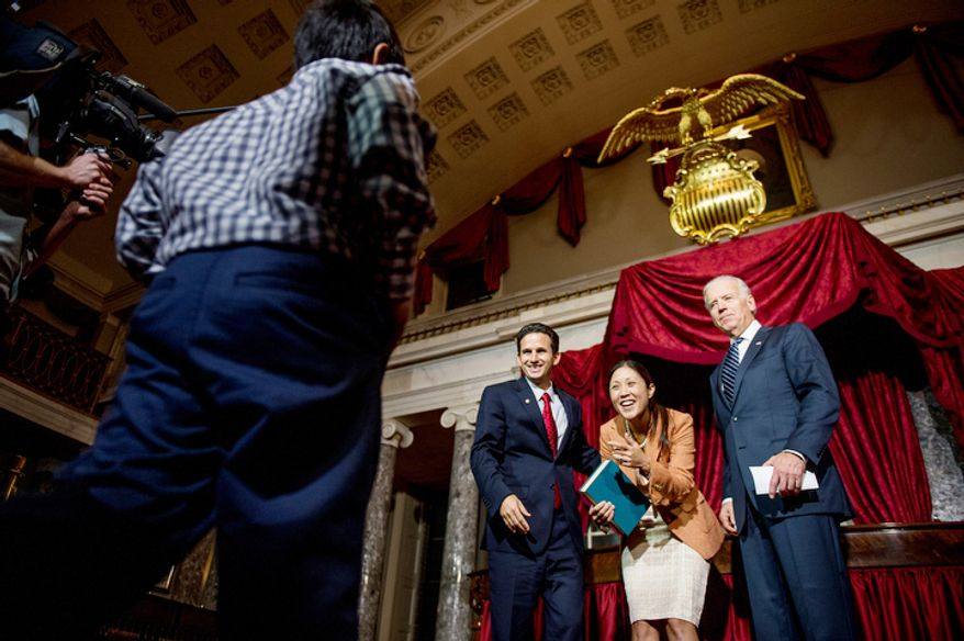 Brian Emanuel Schatz (D-Hawaii) and his wife Linda motion for their son Tyler, 9, after re-enacting Schatz's swearing in ceremony with Vice President Joe Biden inside the old Senate Chamber at the U.S. Capitol Building, Washington, D.C., Thursday, December 27, 2012. Schatz, who was the Lt. Gov. for Hawaii was selected by Hawaii Gov. Neil Abercrombie to the U.S. Senate seat left vacant by the late Daniel K. Inouye. (Andrew Harnik/The Washington Times)