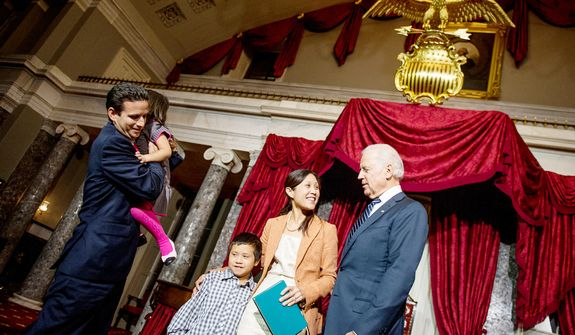 Brian Emanuel Schatz (D-Hawaii) and his wife Linda greet their children Tyler, 9, third from left, and Mia, 4, second from left, after re-enacting Schatz's swearing in ceremony with Vice President Joe Biden inside the old Senate Chamber at the U.S. Capitol Building, Washington, D.C., Thursday, December 27, 2012. Schatz, who was the Lt. Gov. for Hawaii was selected by Hawaii Gov. Neil Abercrombie to the U.S. Senate seat left vacant by the late Daniel K. Inouye. (Andrew Harnik/The Washington Times)