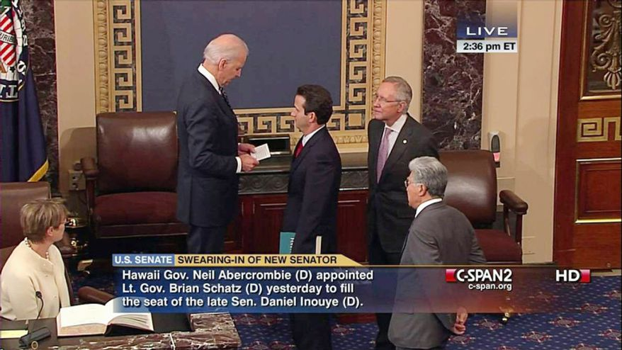 This handout video frame grab image provided by C-SPAN2 shows Vice President Joe Biden, left, administering the Senate Oath to Hawaii's newest Sen. Brian Schatz, center, as Senate Majority Leader Harry Reid of Nev., second from right, and retiring Hawaii Sen. Daniel Akaka, right, watch, Thursday, Dec. 27, 2012, on the Senate floor on Capitol Hill in Washington, Dec. 27, 2012, Schatz replaces Sen. Daniel Inouye, D-Hawaii who died last week. Akaka is retiring and will be succeeded by Rep. Mazie Hirono who was elected in November. (AP Photo/C-SPAN2)
