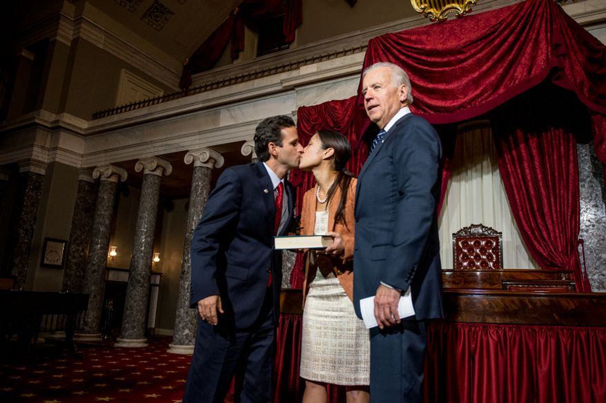 Brian Emanuel Schatz (D-Hawaii), kisses his wife, Linda, after re-enacting his swearing-in ceremony with Vice President Joe Biden inside the old Senate Chamber at the U.S. Capitol Building, Washington, D.C., Thursday, Dec. 27, 2012. Schatz, who was the Lieutenant Governor for Hawaii was selected by Hawaii Gov. Neil Abercrombie to the U.S. Senate seat left vacant by the late Daniel K. Inouye. (Andrew Harnik/The Washington Times)