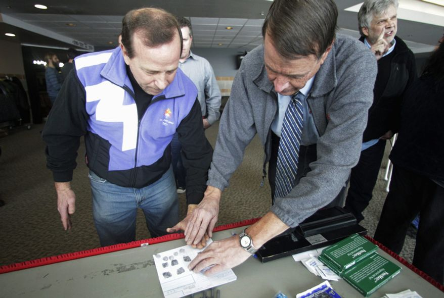Stephen Pratt, a third-grade teacher from Alpine, Utah, is fingerprinted for a gun carry permit Dec. 27, 2012, during concealed-weapons training for 200 Utah teachers in West Valley City, Utah. The Utah Shooting Sports Council offered six hours of training in handling concealed weapons in the latest effort to arm teachers to confront school assailants. (Associated Press)