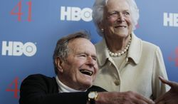 **FILE** Former President George H.W. Bush and his wife, Barbara, arrive June 12, 2012, for the premiere of HBO's new documentary on his life near the family compound in Kennebunkport, Maine. (Associated Press)