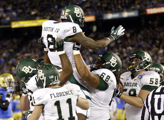 Baylor running back Glasco Martin is lifted by teammates after scoring a touchdown against UCLA during the first half of Baylor's 49-26 win in the Holiday Bowl on Dec. 27, 2012, in San Diego. (Associated Pres