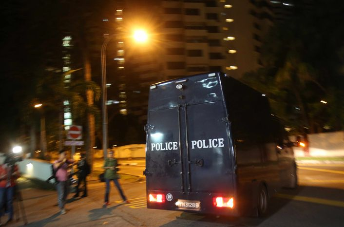 A police hearse leaves Mount Elizabeth Hospital on Saturday Dec. 29, 2012, in Singapore. A young Indian woman who was gang-raped and severely beaten on a bus in New Delhi died Saturday at the hospital, after her horrific ordeal galvanized Indians to dema