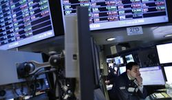 A trader works on the floor at the New York Stock Exchange in New York on Dec. 28, 2012. (Associated Press)