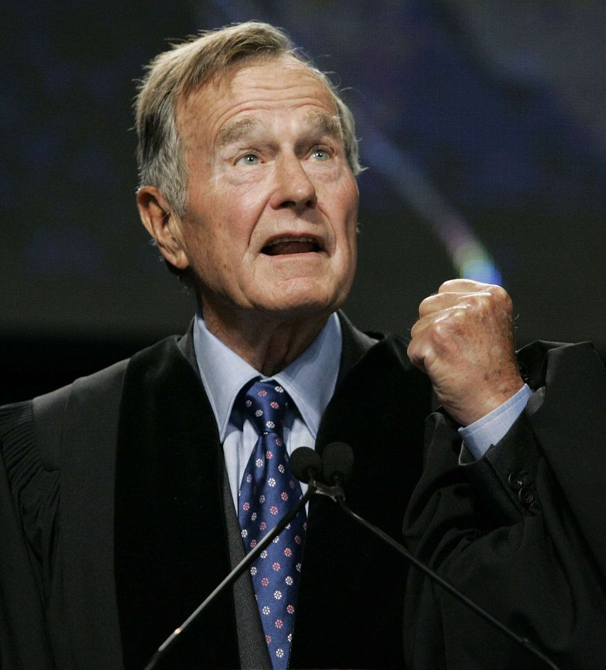 ** FILE ** In this Sept. 21, 2006, file photo, former President George H.W. Bush delivers the keynote speech before receiving an honorary Doctor of Public Administration degree at Suffolk University in Boston. A spokesman says the former president's condition continues to improve and that he was moved Saturday out of intensive care and into a regular hospital room. (AP Photo/Elise Amendola, Pool, File)