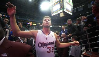 Los Angeles Clippers power forward Blake Griffin walks off the court after the Clippers' 116-114 victory over the Utah Jazz in an NBA basketball game Friday, Dec. 28, 2012, in Salt Lake City. (AP Photo/Rick Bowmer)