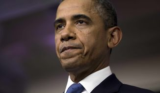 **FILE** President Obama pauses during a statement on the fiscal cliff negotiations with congressional leaders in the briefing room of the White House on Dec. 28, 2012. (Associated Press)
