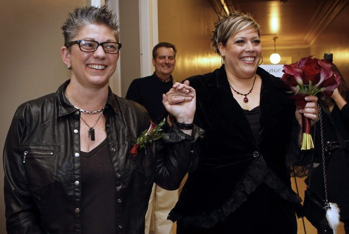 Donna Galluzzo, left, and Lisa Gorney leave the City Clerk's office after obtaining their marriage license, early Saturday, Dec. 29, 2012, at City Hall in Portland, Maine. Same-sex couples in Maine are now legally permitted to marry under a new law that went into effect at 12:01 a.m. on Saturday. (AP Photo/Robert F. Bukaty)