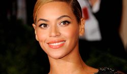 ** FILE ** This May 7, 2012 photo shows Beyonce Knowles at the Metropolitan Museum of Art Costume Institute gala benefit, celebrating Elsa Schiaparelli and Miuccia Prada in New York. HBO announced Monday, Nov. 26, 2012, that a documentary about the Grammy-winning singer will debut Feb. 16, 2013. Beyonce is directing the film and it will include footage she shot herself with her laptop. (AP Photo/Evan Agostini)