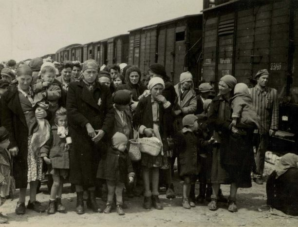 ** FILE ** Jewish women and children deported from Hungary, separated from the men, line up for selection on the selection platform at the Auschwitz camp in Birk