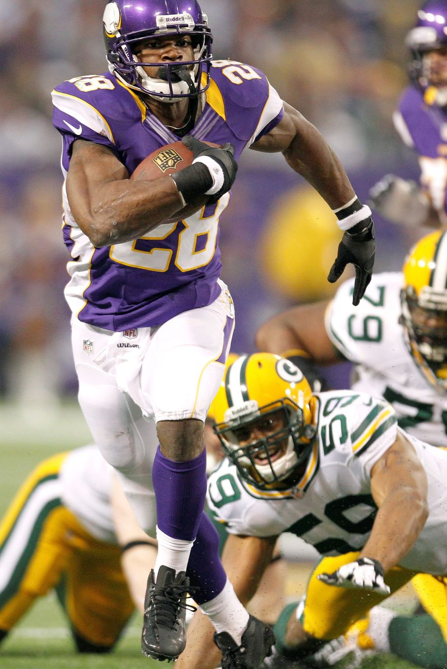 Minnesota's Adrian Peterson ran for 199 yards against Green Bay, finishing 9 yards shy of setting a single-season record for rushing yards. (Associated Press)