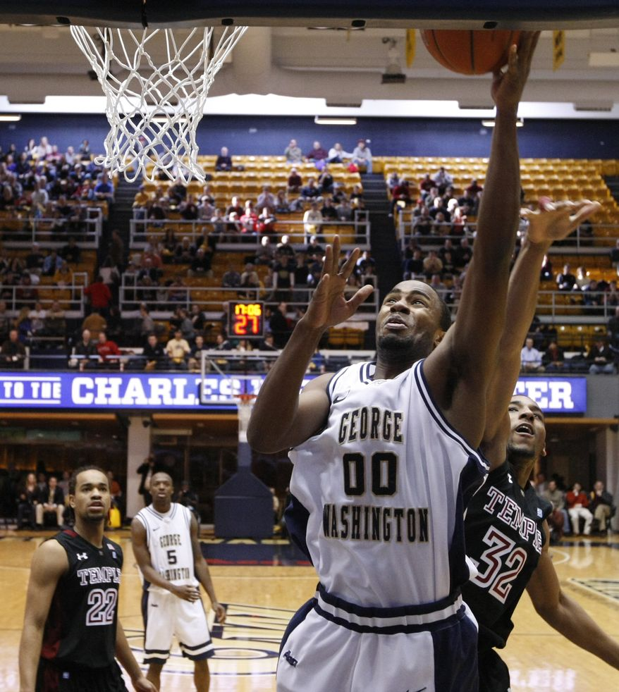 George Washington's Dwayne Smith (00) had 10 points and five rebounds in only 14 minutes Sunday, a 77-38 win over Sacred Heart. (AP Photo/Luis M. Alvarez)