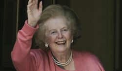 ** FILE ** Former British Prime Minister Margaret Thatcher waves to members of the media on Monday, June 29, 2009. She died Monday, April 8, 2013, of a stroke. (AP Photo/Lefteris Pitarakis)