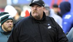 Philadelphia Eagles head coach Andy Reid walks on the field before an NFL football game against the New York Giants, Sunday, Dec. 30, 2012, in East Rutherford, N.J. (AP Photo/Bill Kostroun)