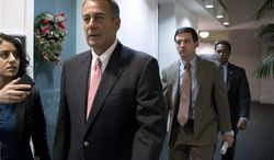 """Speaker of the House John Boehner, Ohio Republican, walks to a closed-door GOP caucus as Congress meets to negotiate a legislative path to avoid the so-called """"fiscal cliff"""" of automatic tax increases and deep spending cuts that could kick in Jan. 1., at the Capitol, Sunday, Dec. 30, 2012. (AP Photo/J. Scott Applewhite)"""