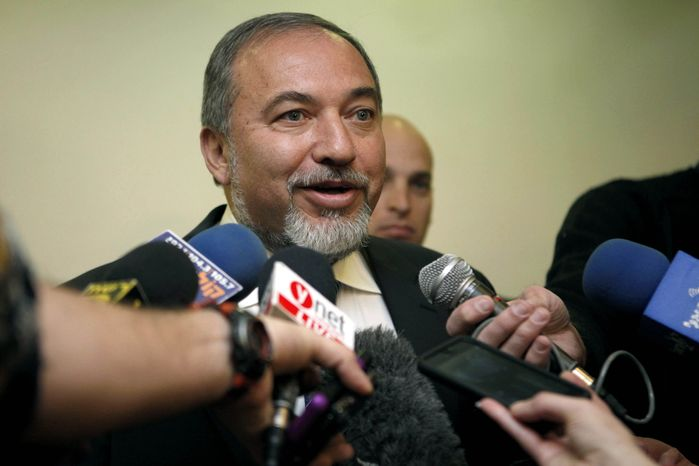 ** FILE ** Then-Israeli Foreign Minister Avigdor Lieberman speaks to journalists as he arrives for the weekly Cabinet meeting at the prime minister's office in Jerusalem on Sunday, Dec. 16, 2012. (AP Photo/Gali Tibbon, Pool)