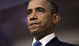 "President Obama pauses during a statement on the ""fiscal cliff"" negotiations with congressional leaders at the White House on Friday, Dec. 28, 2012, in Washington. (AP Photo/Evan Vucci)"