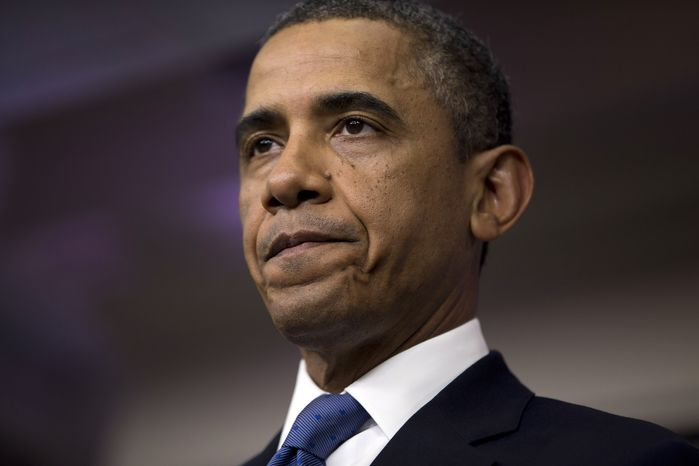 """President Obama pauses during a statement on the """"fiscal cliff"""" negotiations with congressional leaders at the White House on Friday, Dec. 28, 2012, in Washington. (AP Photo/Evan Vucci)"""