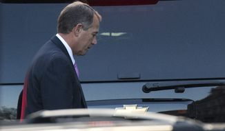 "House Speaker John A. Boehner, Ohio Republican, leaves the White House in Washington on Friday, Dec. 28, 2012, after a closed-door meeting between President Obama and congressional leaders to negotiate the framework for a deal on the ""fiscal cliff."" (AP Photo/Evan Vucci)"