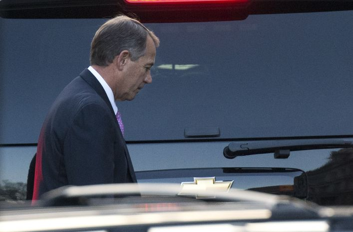 """House Speaker John A. Boehner, Ohio Republican, leaves the White House in Washington on Friday, Dec. 28, 2012, after a closed-door meeting between President Obama and congressional leaders to negotiate the framework for a deal on the """"fiscal cliff."""" (AP Photo/Evan Vucci)"""