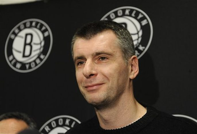 Brooklyn Nets principal owner Mikhail Prokhorov speaks to the media concerning the firing of head coach Avery Johnson at halftime during an NBA game against the Charlotte Bobcats on Friday, Dec. 28, 2012 at Barclays Center in New York. (AP Photo/Kathy Kmonicek)