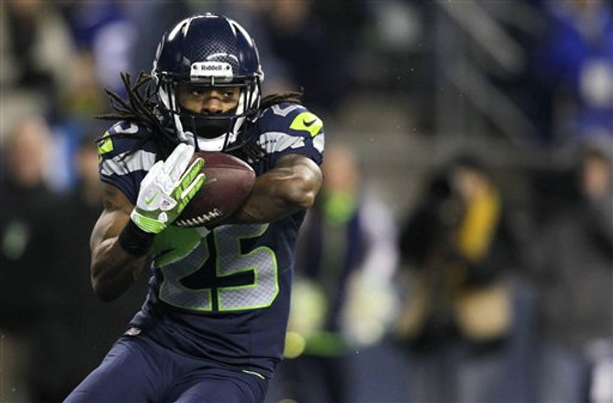 Seattle Seahawks' Richard Sherman intercepts a pass from St. Louis Rams quarterback Sam Bradford in the second half of an NFL football game, Sunday, Dec. 30, 2012, in Seattle. The Seahawks defeated the Rams 20-13. (AP Photo/Stephen Brashear)