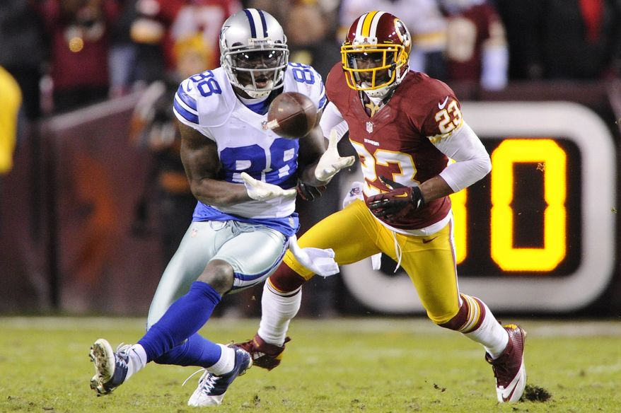 Dallas Cowboys wide receiver Dez Bryant (88) hauls in a first down reception in front of Washington Redskins cornerback DeAngelo Hall (23) during second quarter action at FedEx Field, Landover, Md., Dec. 30, 2012. (Preston Keres/Special to The Washington Times)
