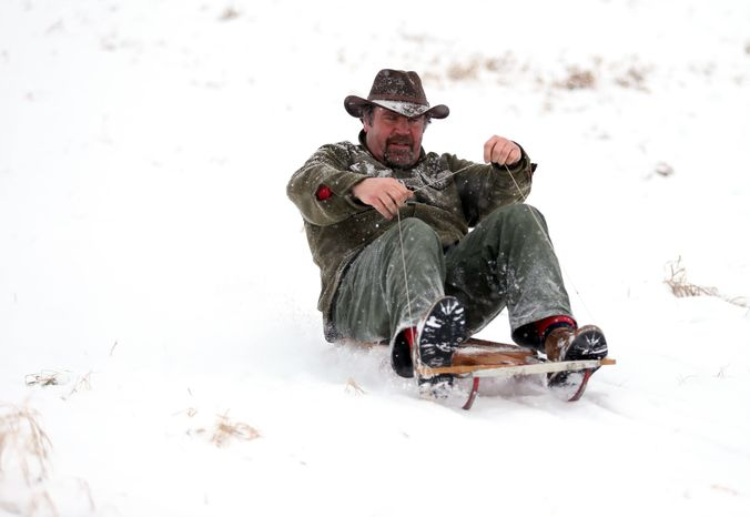 Matt Nigro sleds down a hill in Lode Star Park in Fredon, N.J., on Saturday, Dec. 29, 2012. Snow from the second winter storm in less than a week fell over most of the Northeast and the upper Ohio River Valley. (AP Photo/The New Jersey Herald, Amy Herzog)
