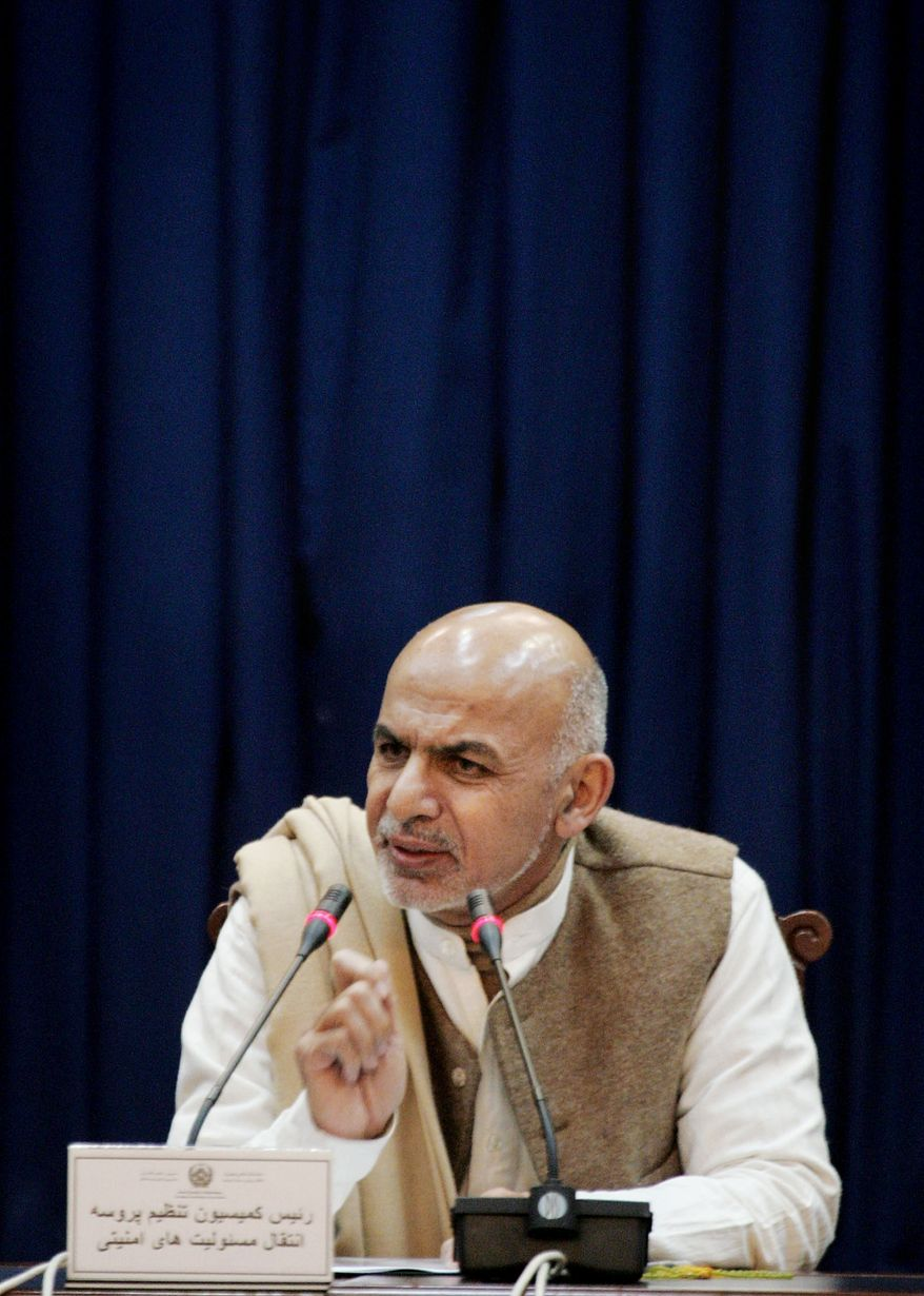Ashraf Ghani Ahmadzai, head of the Afghan security transition commission, speaks during a press conference in Kabul, Afghanistan, on Monday, Dec. 31, 2012. The next phase of transferring security from NATO to Afghan control will begin in two months and will aim to cover nearly 90 percent of the country's population, the Kabul government announced. (AP Photo/Ahmad Nazar)